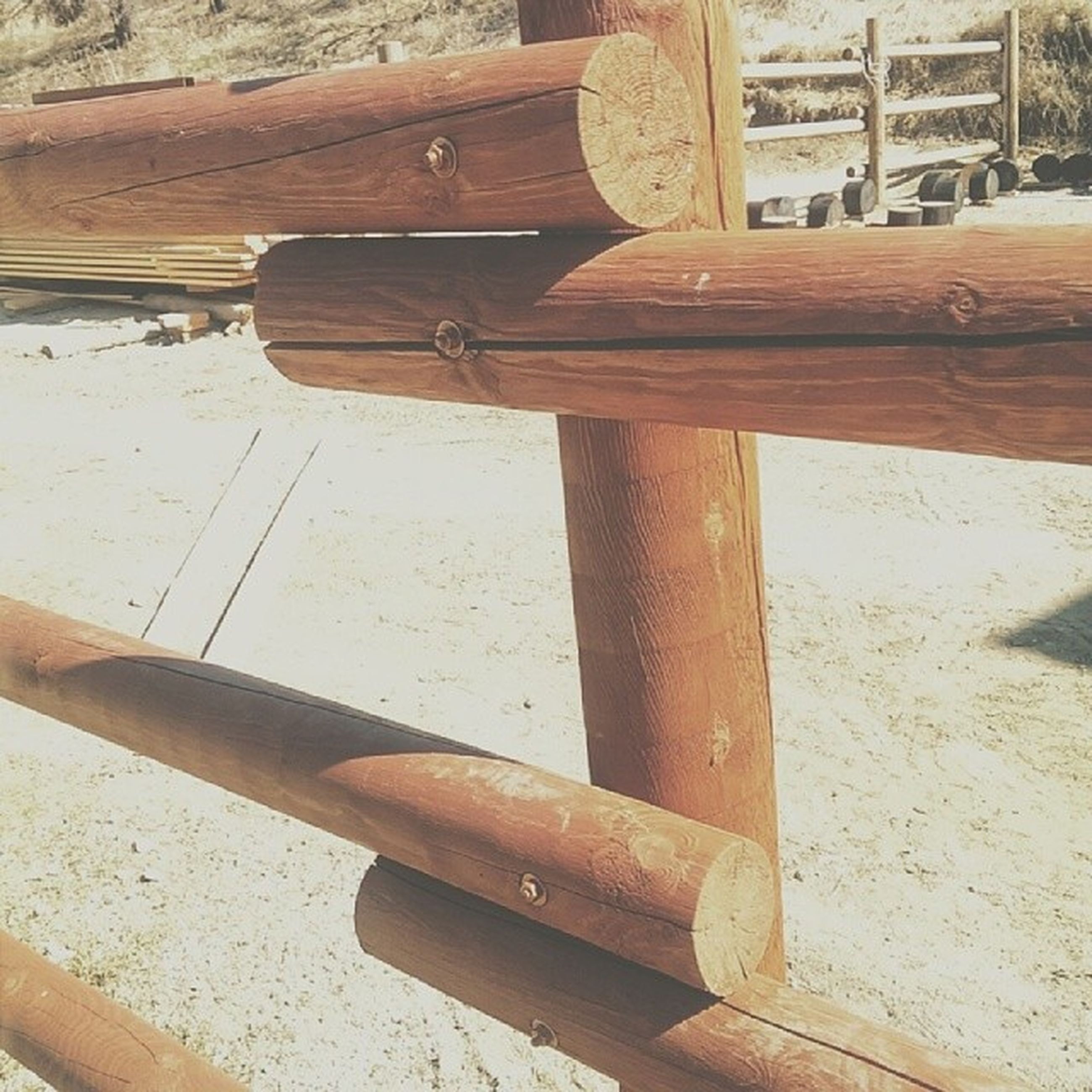 wood - material, wooden, wood, bench, sunlight, built structure, old, day, no people, close-up, outdoors, metal, shadow, plank, chair, high angle view, empty, architecture, absence, brown