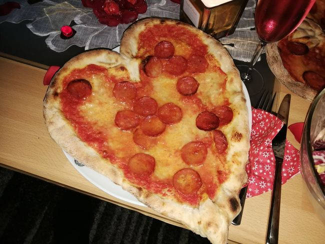 Heart shaped pizza Pizza Heart Shape Heart Romantic Love Dinner Food Food And Drink Indoors  No People Freshness Indulgence Sweet Food Ready-to-eat