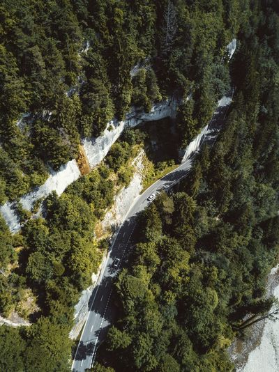 Aerial View Cliff Face Cliffside Driving Driving Car Dronephotography Forest Mountain Mountain Road Road Rockface Scenics Speed Tree Trees