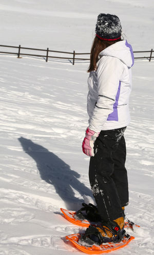little girl with sportwear and orange snowshoes in mountains Check This Out Children Snow ❄ Snowshoe Casual Clothing Child Childhood Children Only Cold Temperature Full Length Leisure Activity Little Girl Little Girl Playing Nature Outdoors Snow Snowing Snowshoe Trip Snowshoeing Snowshoes Warm Clothing Winter