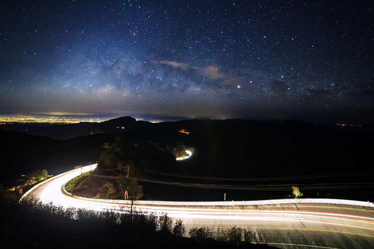 Night Star - Space Astronomy Space Galaxy Sky Scenics - Nature Illuminated Nature Star Beauty In Nature No People Star Field Light Trail Long Exposure Transportation Motion Water Outdoors Mountain Milky Way