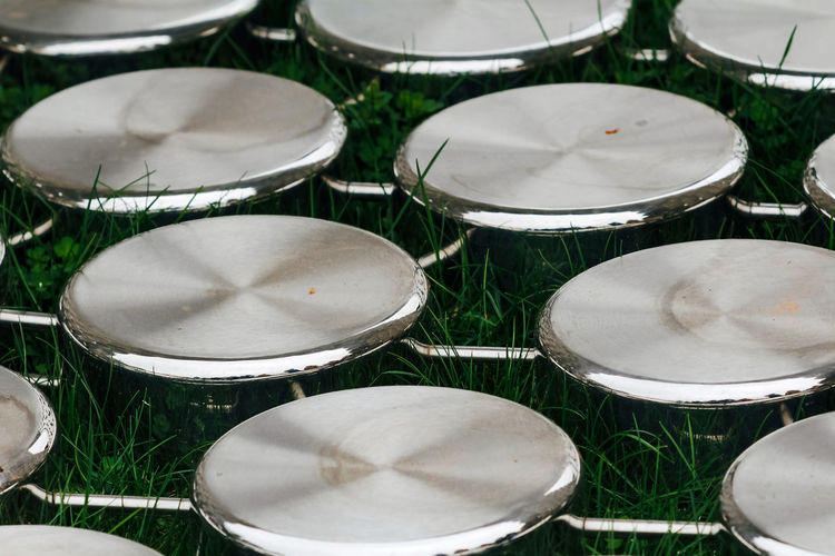 No People Grass Land Close-up Day Field Musical Equipment Musical Instrument Selective Focus Geometric Shape Outdoors Metal Nature Choice Circle Music Shape Arrangement Variation Plant