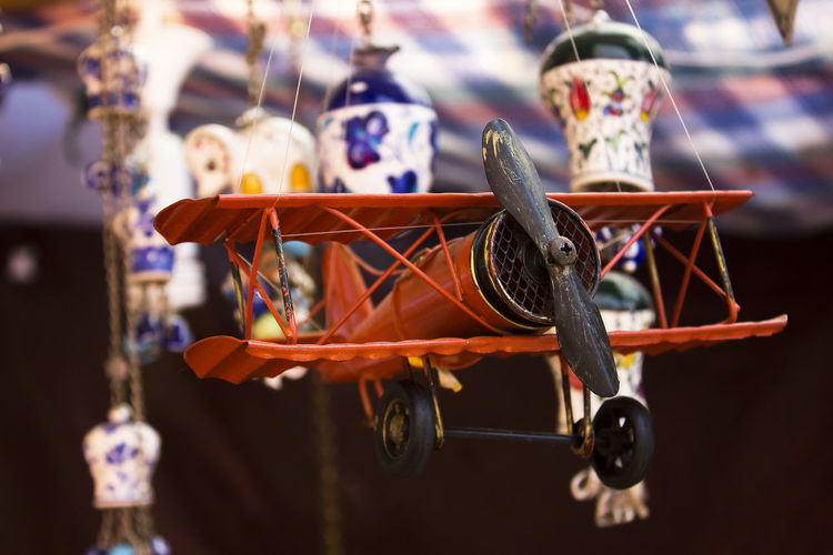 Close-up of toy hanging at market stall