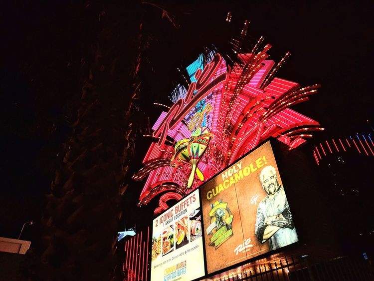 as seen from a sidewalk off flamingo road Illuminated Low Angle View Multi Colored Outdoors Eyem Gallery What I See Taking Photos Las Vegas Night Photography Night Lights Hotels And Resorts Neon FlashingLights Vegas  Palm Tree Las Vegas At Night Casino Vegas  Looking For Inspiration