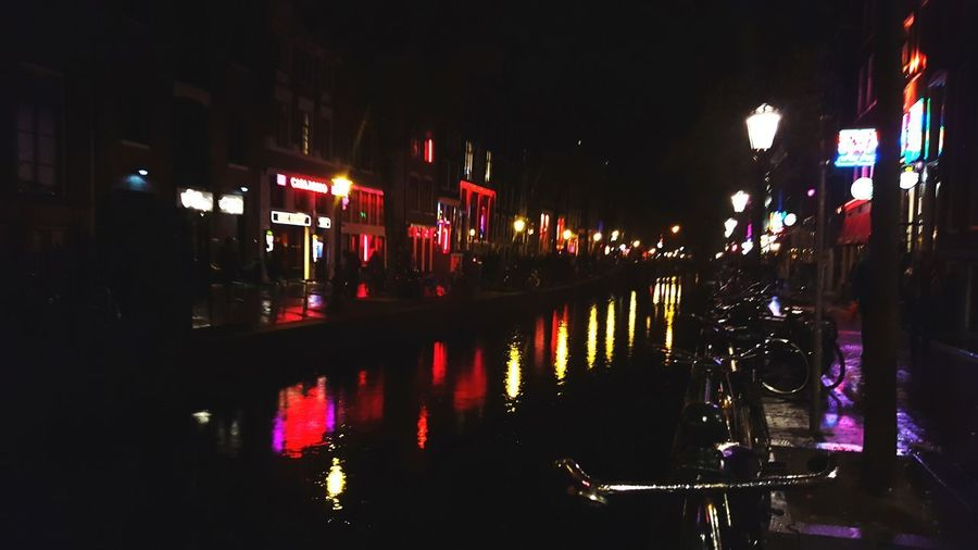 Reflection Night Illuminated No People Outdoors Architecture City Redlights Redlightsdistrict Amsterdam Lights Nightphotography Night Lights Amsterdamcity Amsterdam City City Nightlife Amsterdam Olanda Netherlands PhonePhotography Traveling Taking Pictures Lights In The Dark Ontheroad