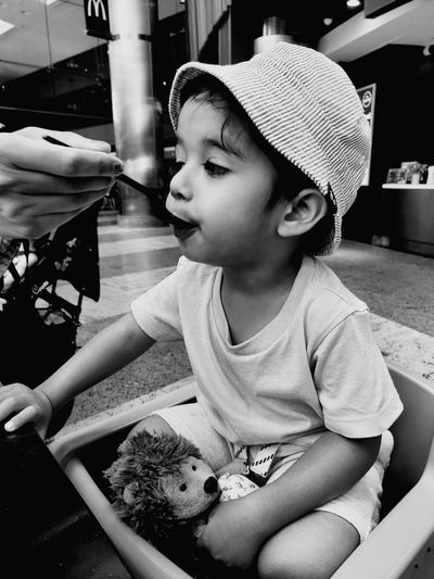 in the moment Highchair Summerdays  Black And White Feeding  Burritto Toddlerlife Hat Teddy Bear Oneplusphotography EyeEm Selects Child Childhood Girls Cute Sitting Headwear Close-up Innocence Toddler  Baby Boys Babyhood Thoughtful