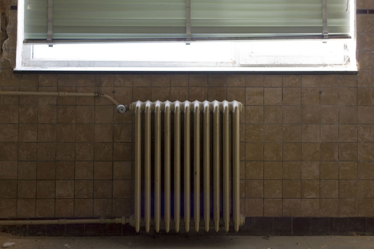 Radiator on wall at home