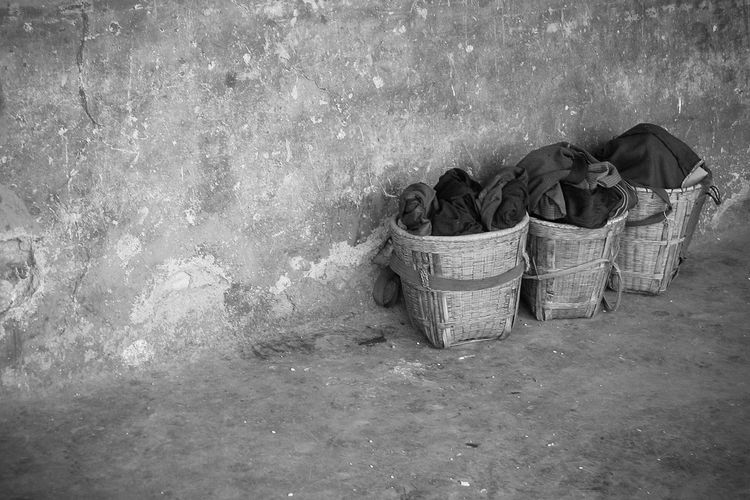 Clothes In Basket Against Wall