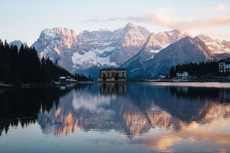 Sundown in the Dolomites. Dolomites, Italy Mountains Reflection Water Lake Mountain Sky Beauty In Nature Tree Scenics - Nature Mountain Range Waterfront Plant Cold Temperature Nature Tranquility Winter Snow Tranquil Scene No People Outdoors Snowcapped Mountain