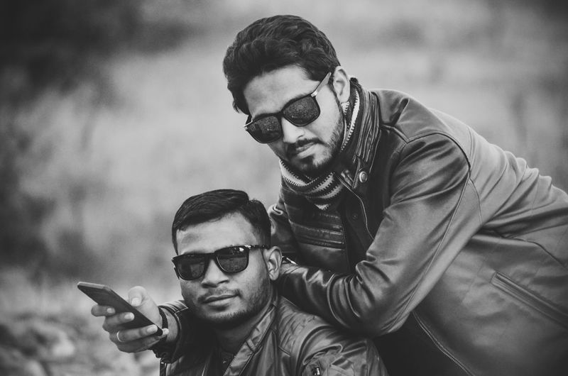 Portrait of male friends wearing sunglasses