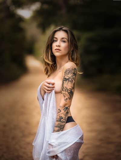 Young Adult One Person Tattoo Lifestyles Young Women Real People Leisure Activity Beauty Outdoors Adults Only Beautiful Woman Standing Nature