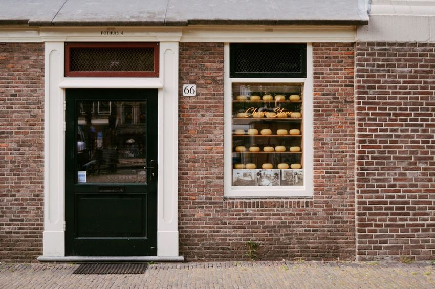 Urban Amesterdam EyeEm Best Shots EyeEmNewHere EyeEm Selects Art Urbanlife Shop Wine Window Façade Brick Wall Door Architecture Building Exterior Built Structure Close-up