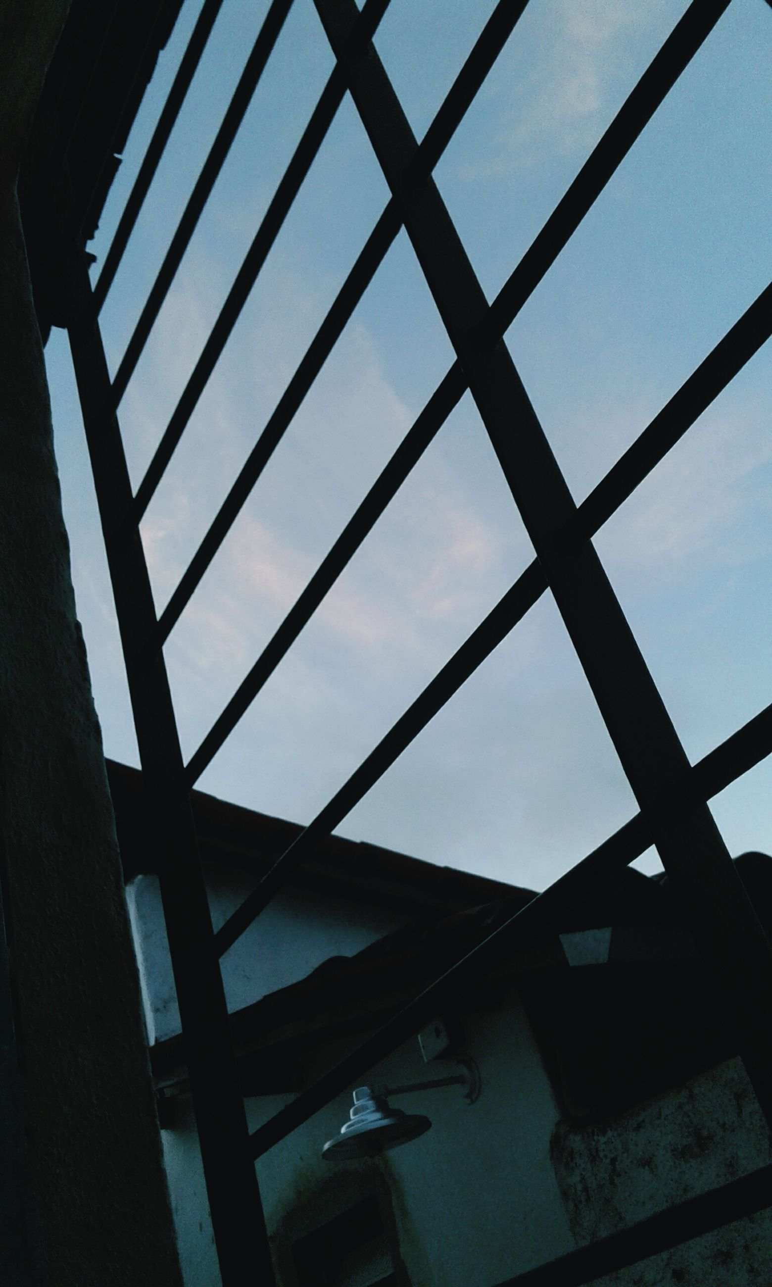 architecture, low angle view, built structure, indoors, sky, bridge - man made structure, day, no people, girder, city
