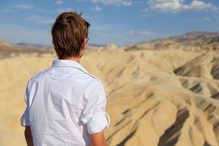 Rear view of teenage boy at desert