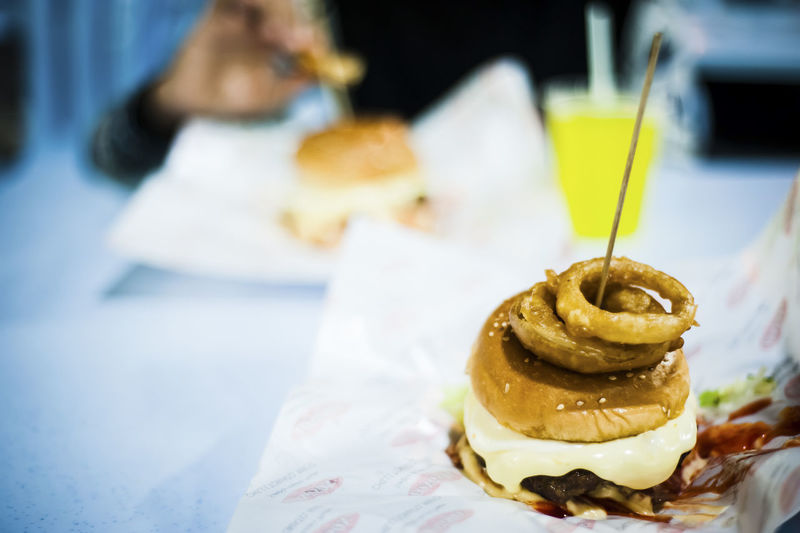Burgers Cake Close-up Dessert Focus On Foreground Food Food And Beverages Food And Drink Food Photography Freshness Holding Indoors  Indulgence Person Ready-to-eat Selective Focus Still Life Still Life Photography Sweet Food Table Temptation Unhealthy Eating