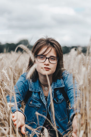Fields of Gold Natural Light Natural Light Portrait Portrait Of A Woman Wheat Wheat Field Woman Day Denim Jacket Eyeglasses  Field Front View Leisure Activity Lifestyles Nature One Person Outdoors Portrait Of A Friend Real People Sky Standing Young Adult Young Women