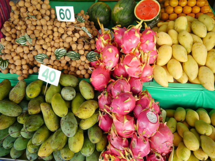 Abundance Arrangement Choice Collection Display Food Food And Drink For Sale Freshness Fruit Fruit Market Full Frame Healthy Eating Large Group Of Objects Mango Market Market Stall Price Tag Price Tag Retail  Sale Small Business Thailand Local Market Tropical Fruits Variation