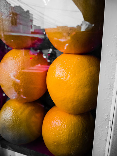 Close-up of orange fruits for sale in market