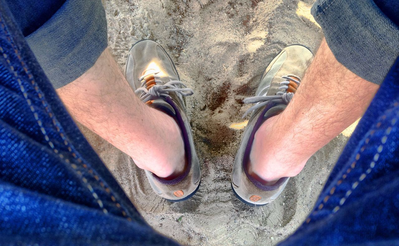 low section, human leg, jeans, shoe, personal perspective, one person, human body part, high angle view, real people, men, standing, human foot, directly above, day, outdoors, casual clothing, leisure activity, lifestyles, close-up, one man only, only men, adult, adults only, people