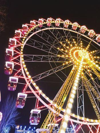 Arts Culture And Entertainment Ferris Wheel Amusement Park Night Illuminated Amusement Park Ride Low Angle View