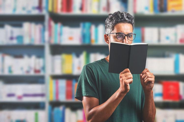 Portrait of man reading book