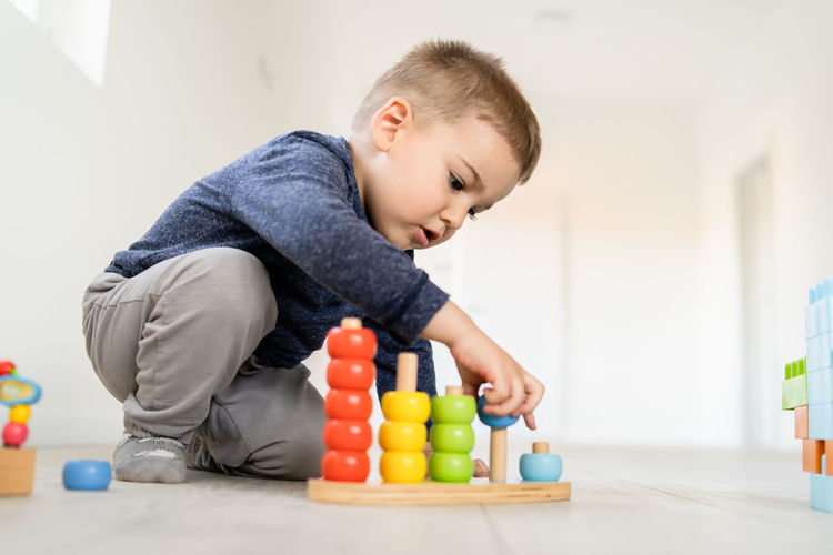 Childhood Child Toy Boys Lifestyles Indoors  One Person Baby Males  Real People Young Men Playing Home Interior Leisure Activity Innocence Looking Focus On Foreground