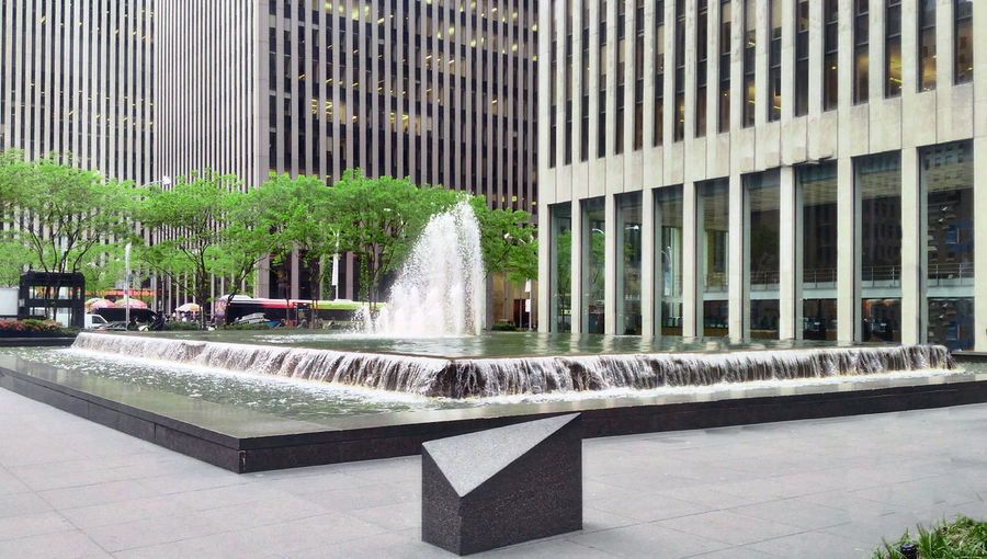 Fountain against building in city
