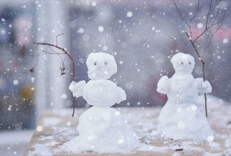 Close-up of snowmen on table