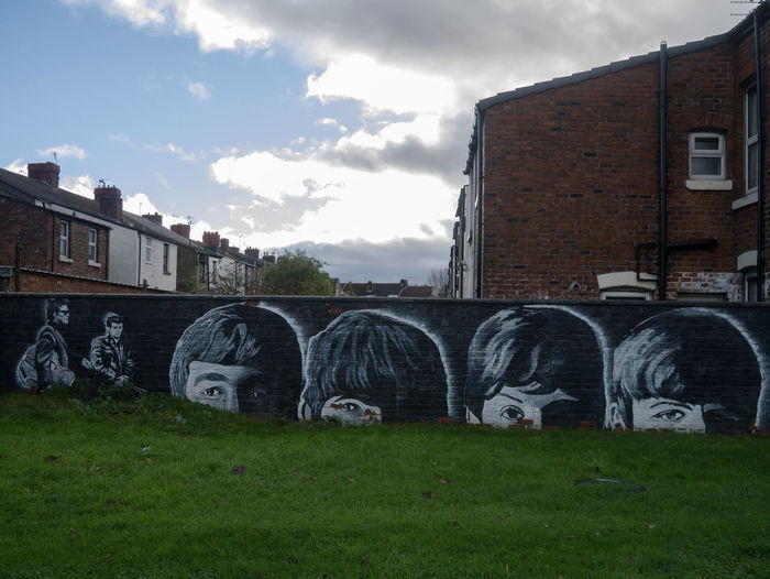 The Beatles mural in Litherland, Liverpool Art Clouds Community Art Faces George Harrison John Lennon Litherland Mural No People Outdoors Paul Mccartney Ringo Starr Scouse The Beatles Wall