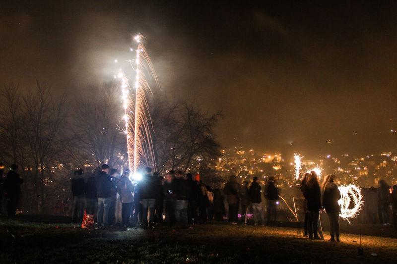 People enjoying fireworks at night