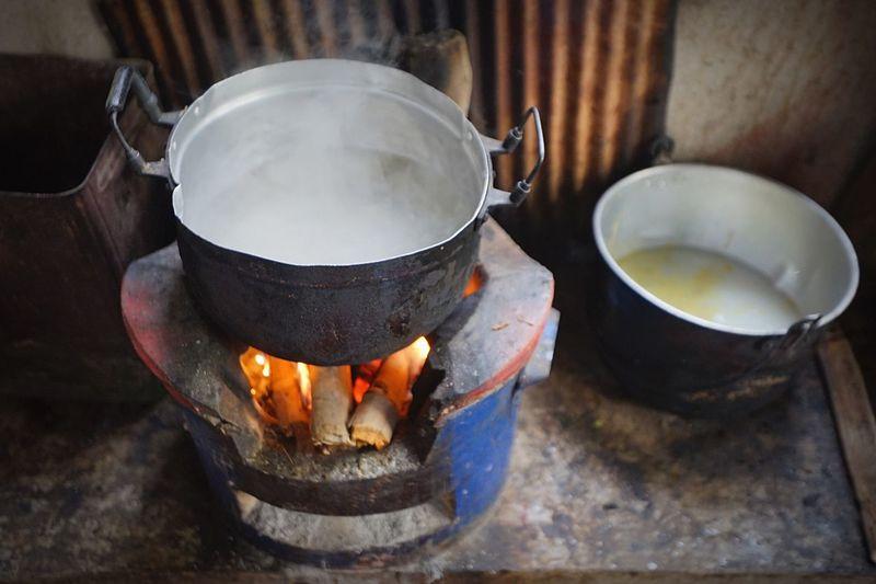 Food preparing in utensil on wood burning stove