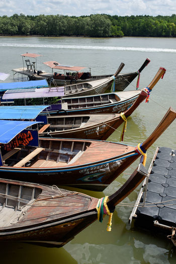 Day Fishing Boat Lake Mode Of Transportation Moored Nature Nautical Vessel No People Non-urban Scene Oar Outdoors Reflection Rowboat Tranquility Transportation Water Waterfront Wood - Material