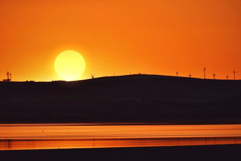 Orange over horizon Hot Day Summer Views EyeEm Selects Reflection Sunset Sky Beauty In Nature Silhouette Orange Color Tranquil Scene Scenics - Nature Water Circle