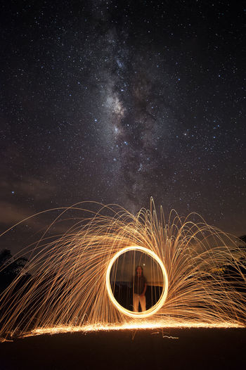Arts Culture And Entertainment Astronomy Blurred Motion Burning Communication Fire Fire - Natural Phenomenon Glowing Illuminated Long Exposure Men Milkyway Motion Nature Night One Person Outdoors Sign Sky Sparks Spinning Star - Space Wire Wool