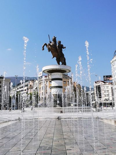 ⛲ Be. Ready. EyeEmNewHere Statue Sculpture Architecture Fountain Horse Built Structure Outdoors Human Representation History Monument Architectural Column Day No People City Water King - Royal Person Town Square Travel Destinations Sky Clear Sky Spraying Building Exterior