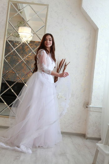 One Person Wedding Newlywed Bride Women Full Length Young Adult Wedding Dress Event Standing Adult Lifestyles Celebration Real People Life Events Front View Smiling Clothing Beautiful Woman Portrait Fashion Hairstyle