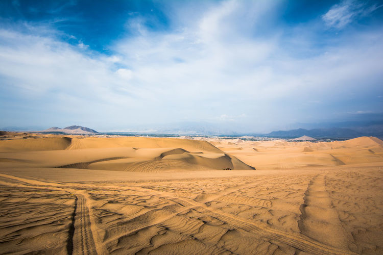 Arid Climate Barren Beauty In Nature Blue Cloud Cloud - Sky Day Desert Dunes Huacachina Huacachina, Peru Idyllic Landscape Nature No People Non-urban Scene Outdoors Physical Geography Remote Scenics The Great Outdoors - 2016 EyeEm Awards Tourism Tranquil Scene Tranquility Travel Destinations