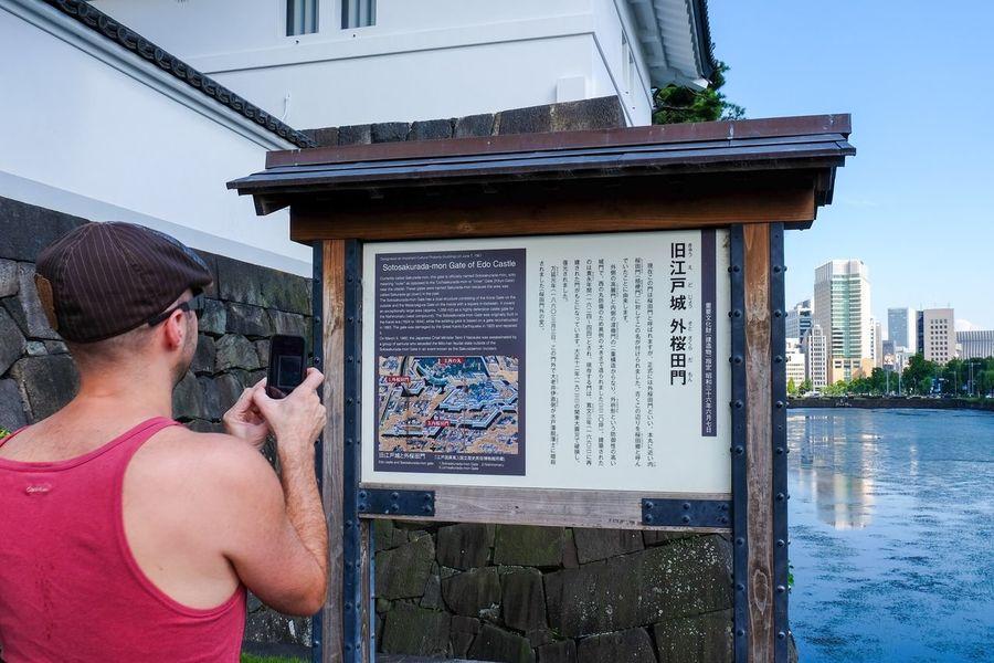 Tourists Tourist Portrait Travelling Travel FUJIFILM X-T1 XF 18-135mm/f3.5-5.6 WR Sakuradamon Sakurada Gate Taking picture of the description pannel of Edo castle. The Portraitist - 2016 EyeEm Awards