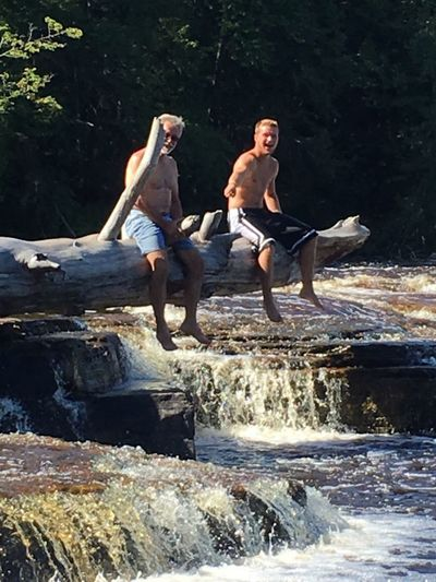Having fun just hanging around Dead Tree Log Over River Togetherness Happy People Waterfall Water Full Length Men Tree Sitting Togetherness Adventure Smiling River Waterfall Flowing Falling Water Stream Power In Nature Rapid Flowing Water EyeEmNewHere