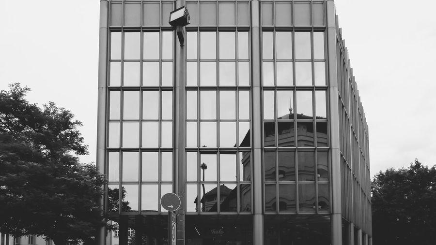 Buildings against clear sky seen through window