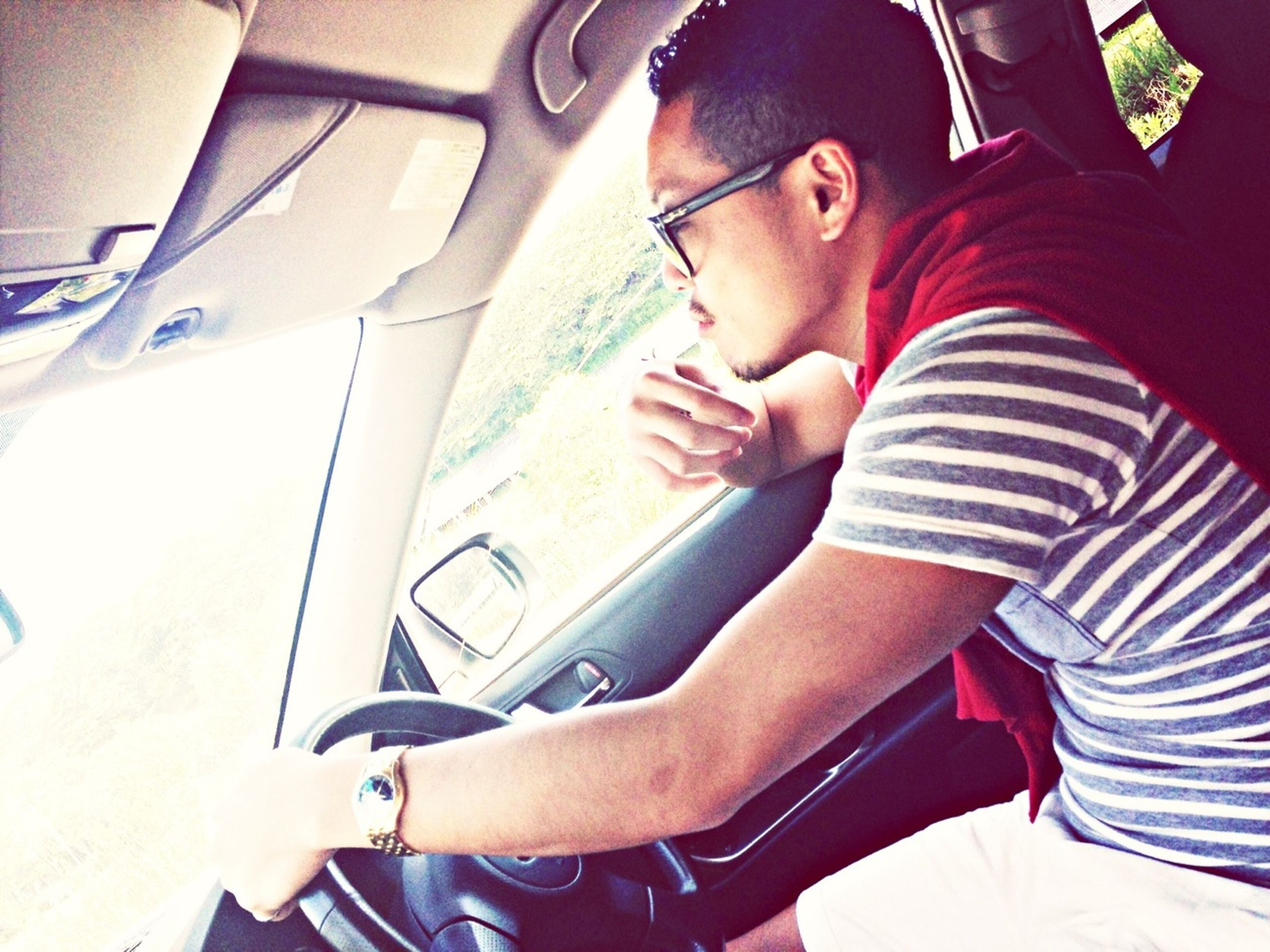transportation, mode of transport, land vehicle, car, vehicle interior, young adult, lifestyles, travel, sitting, car interior, leisure activity, person, vehicle seat, young men, journey, sunglasses, casual clothing