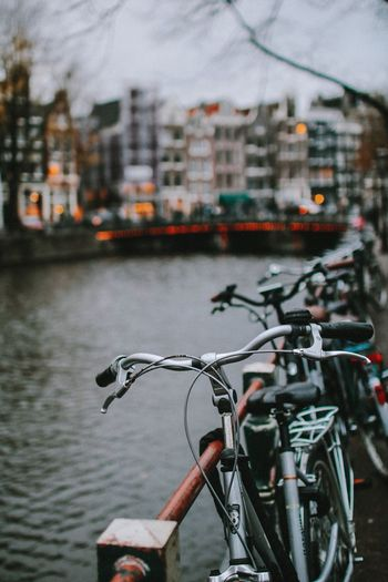 Amsterdam Bicycle Mode Of Transportation Transportation Architecture Land Vehicle Built Structure Building Exterior City Day Parking Close-up Outdoors Building Focus On Foreground No People Street Stationary Travel Road Nature