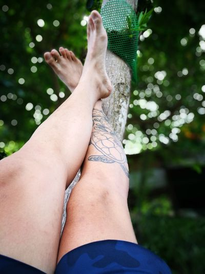 Low section of man with tattoo on leg