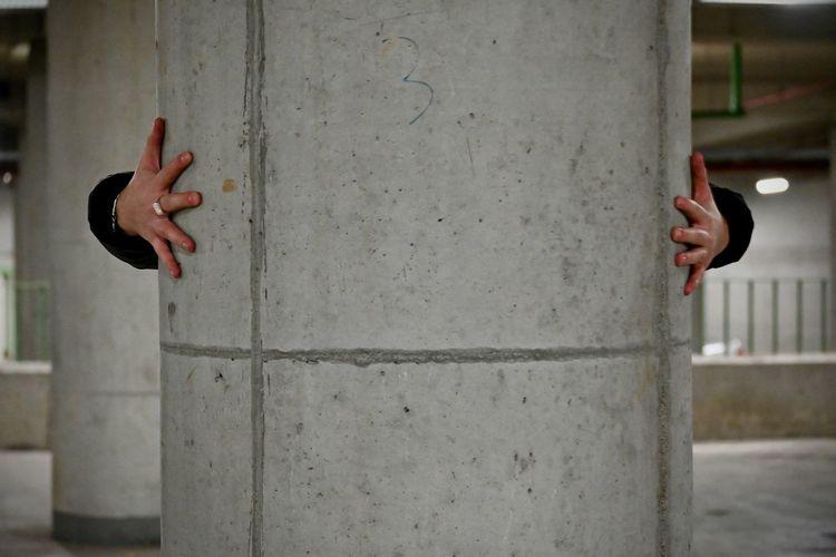 Full length of hand on wall