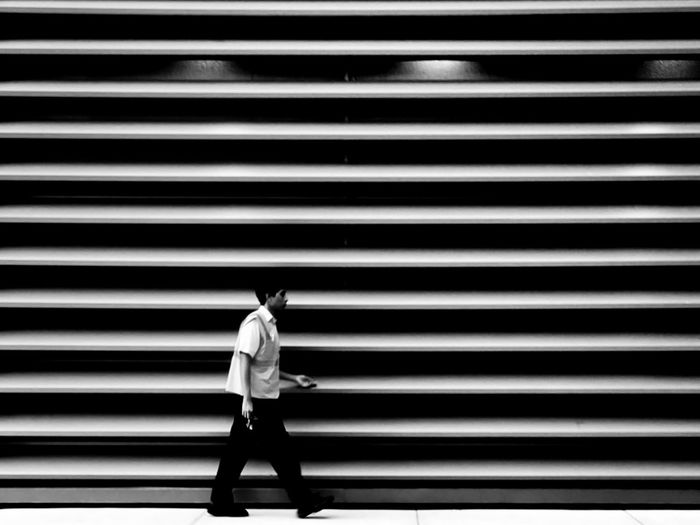 Shadow of man walking on shutter