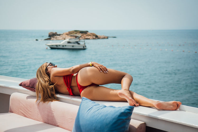 Relaxation Sea Water Lifestyles Real People Lying Down Young Adult Young Women One Person Nature Leisure Activity Horizon Resting Women Adult Horizon Over Water Nautical Vessel Clothing Beautiful Woman