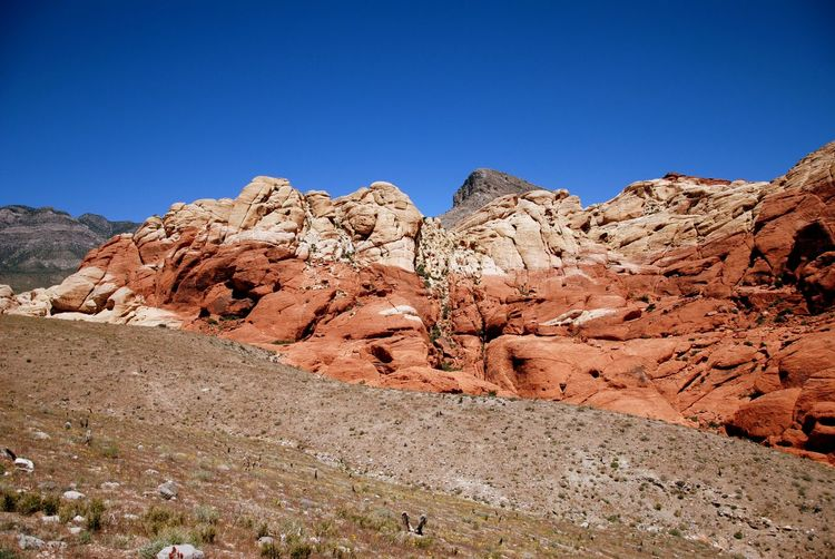 Scenic view of red rock canyon mountains against clear sky