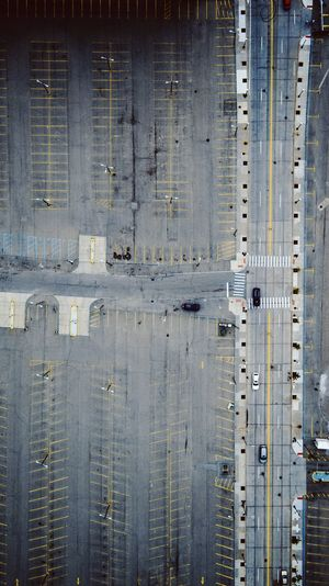 Aerial view of parking lot by city street