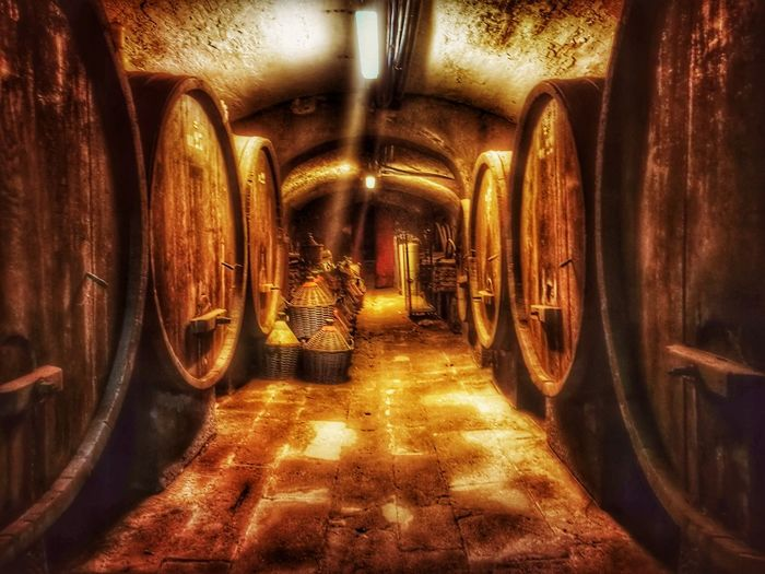 Indoors  The Way Forward Illuminated No People Wine Winery Cellar Wine Cask Day Botte Damigiana Barrel Barrels Of Wine Be. Ready.
