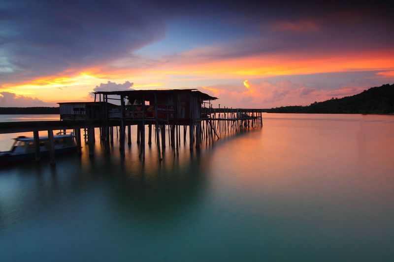 Architecture Bay Beauty In Nature Building Exterior Built Structure Cloud - Sky Dusk House Nature No People Orange Color Outdoors Scenics - Nature Sea Sky Stilt Stilt House Sunset Tranquil Scene Tranquility Water